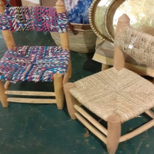 Wooden chairs with seagrass or coloured cloth seats and backs